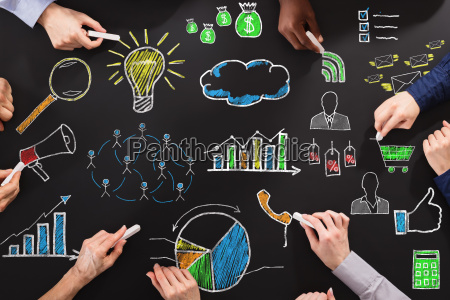 hands drawing business strategy with chalk