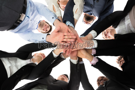 multiracial people stacking hands