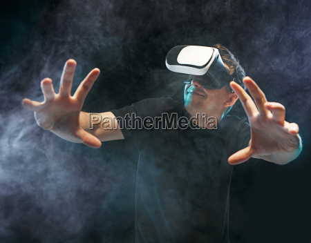 the man with glasses of virtual