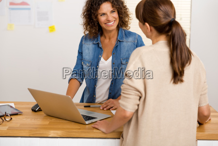 two businesswoman working together