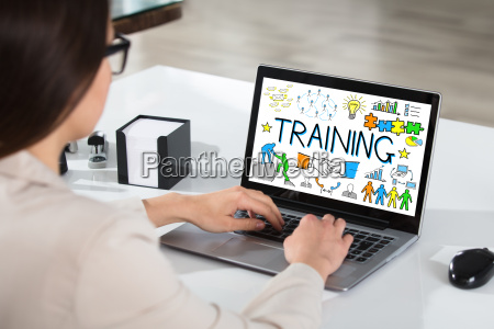 businesswoman using laptop showing training concept