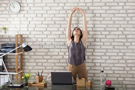 businesswoman stretching