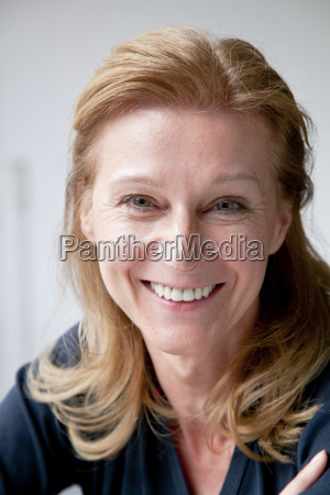 portrait of smiling mature woman over