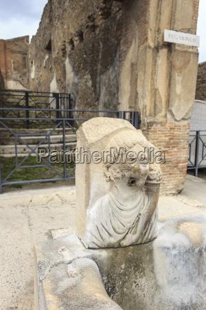 public fountain on cobbled street roman