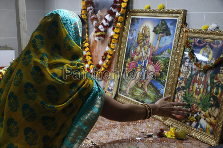 faithful touching pictures of deities shree