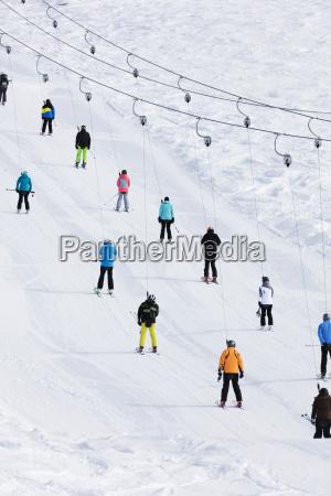 skiers on a drag lift veysonnaz