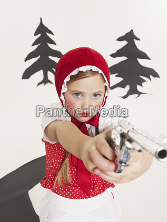 little girl dressed up as red