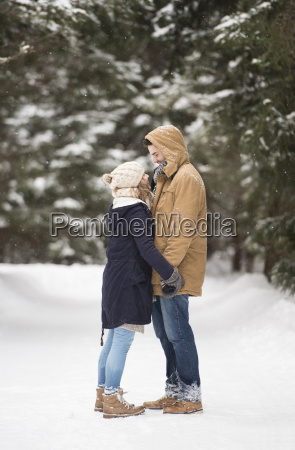 happy young couple standing face to