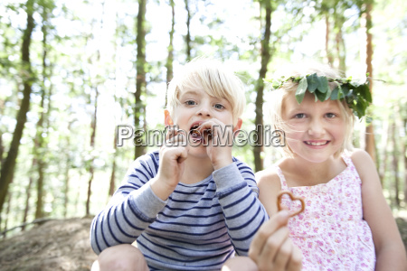 boy and girl in forest eating