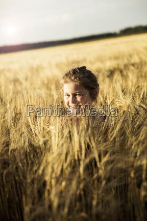happy girl in grain field