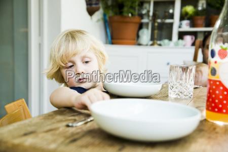 portrait of blond little boy laying