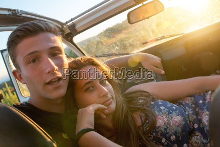 happy couple in a car