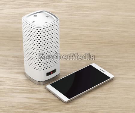 altofalante e smartphone no fundo de