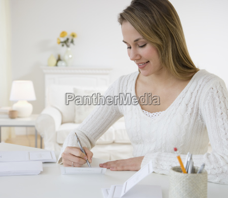 woman writing at desk