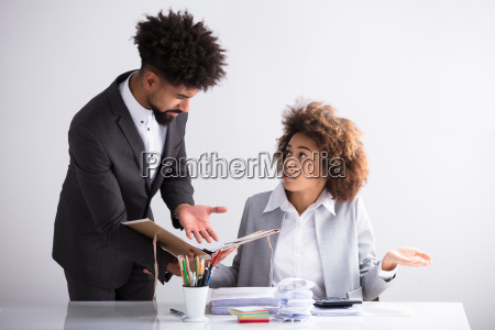 businessman showing mistake to his female