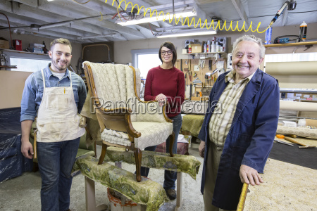 senior caucasian man upholsterer and his