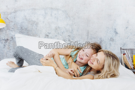 beautiful mother and daughter cuddle up