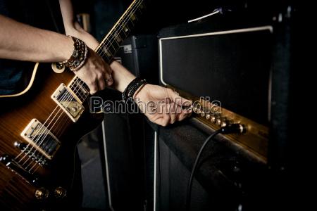 cropped image of guitarist playing music