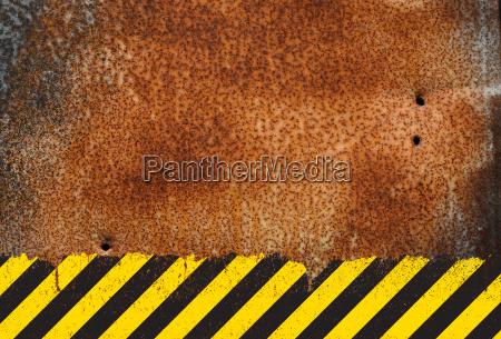 rusty metal background with grunge hazard