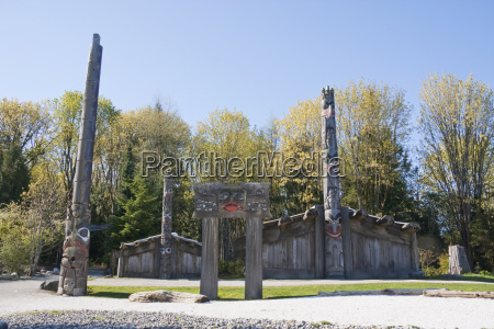 totem poles and haida houses on