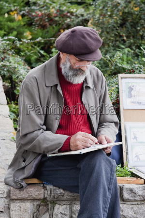 old artist drawing budapest hungary