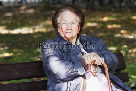 old woman sitting on a park