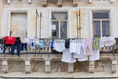 laundry hanging from a balcony valletta