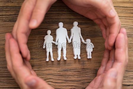 mao proteger grupo par crianca familia