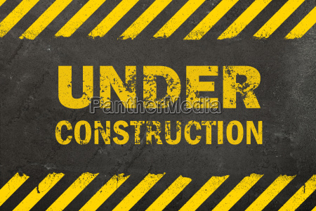 concrete background with under construction sign