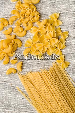 uncooked spaghetti and farfalle pasta