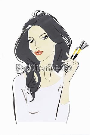 beautiful woman looking at camera holding