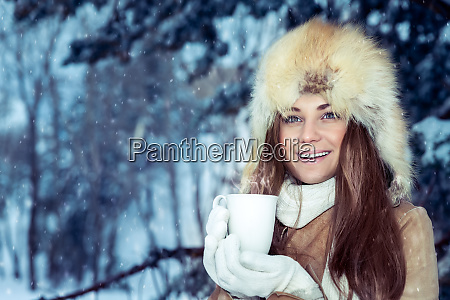 happy girl with cup of tea
