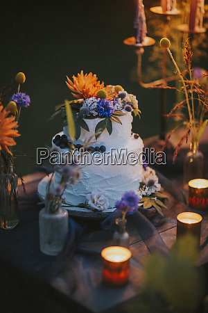 wedding cake on table with candles