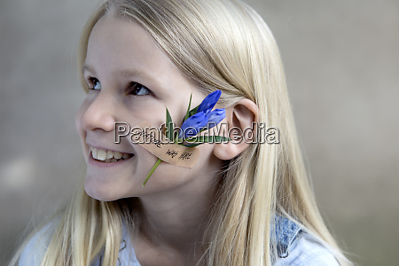 portrait of smiling blond girl with