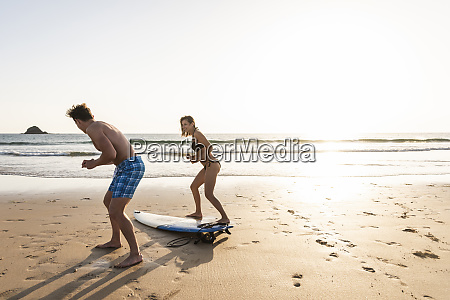 young man showing young woman how