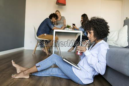 woman with soft drink sitting on