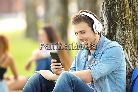 student listening music with headphones in