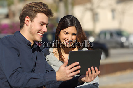 couple watching media content in a
