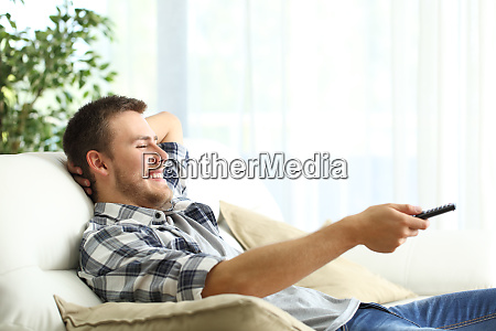 happy man relaxing watching tv at