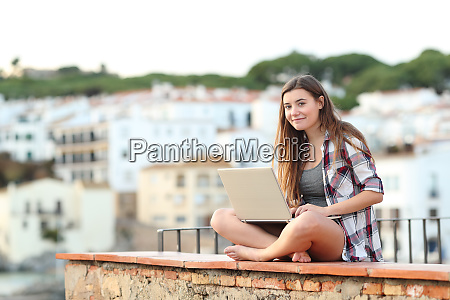 teenage girl looking at camera using