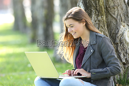 happy teen writing on line in