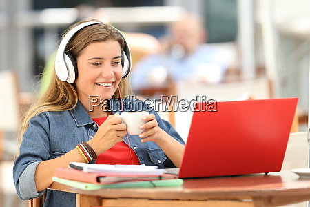 relaxed student watching media in a