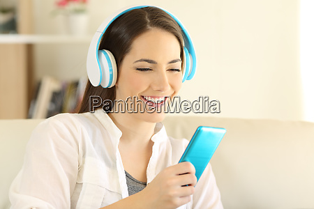 happy teen listening to music using