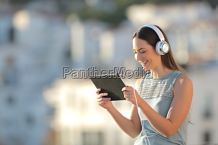 woman watching media in a tablet