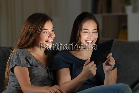friends watching media content in a