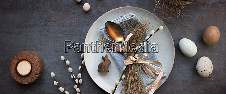easter place setting on dark table