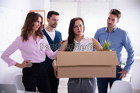young businesswoman leaving in office