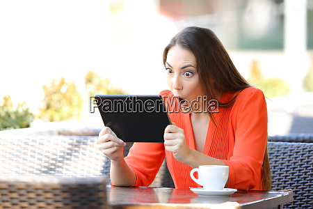 shocked woman watching and listening media