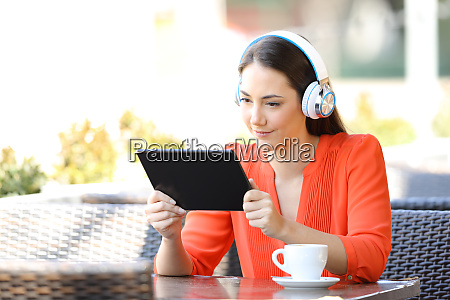 woman watching and listening media on