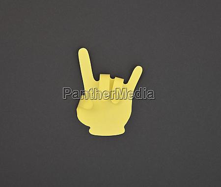 paper made yellow horns gesture sticker